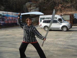 Sensei Bryce in China with a pair of Dragon Swords*