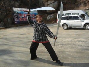 Sensei Bryce in China with a pair of Dragon Swords