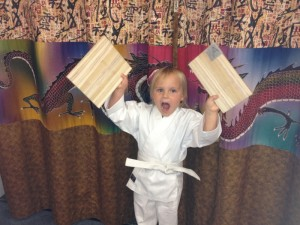 Family Martial Arts Academy, first board break for confidence building at our Beaverton, Oregon 97008 location.  All new students earn their white belts performing basic karate skills and breaking their first board.  They learn by experience that they can succeed.