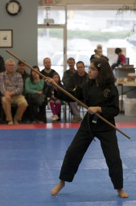 Traditional Okinawan Weapons include the Bo or staff to enhance our martial arts programs.