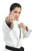 Karate woman punching at camera